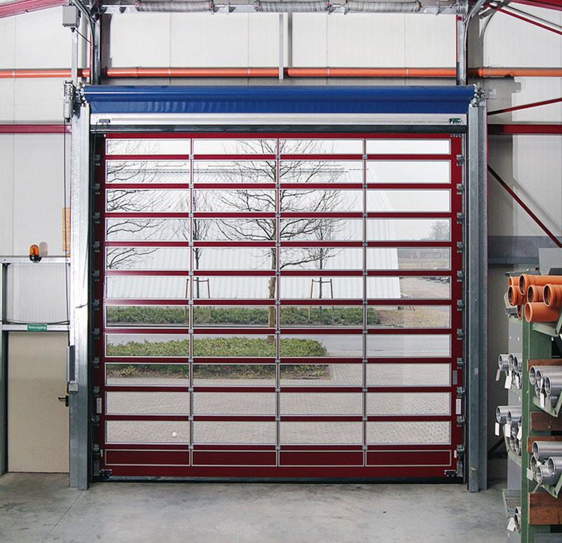 Wintec Tor-Systeme e.k - Nickelstraße 49 33378 Rheda-Wiedenbrück | Alu-Rohrrahmentor einer Halle von außen